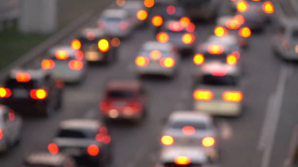 Cars in traffic,out of focus.Urban traffic jams. Cars in traffic,out of focus.Urban traffic jams. transportation traffic stock pictures, royalty-free photos & images