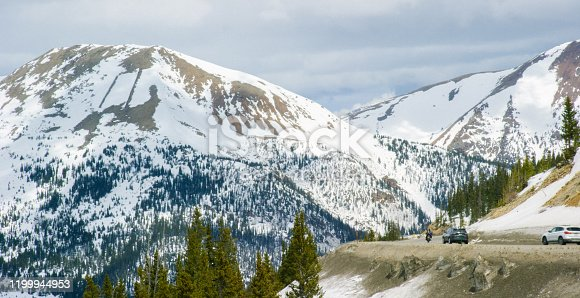 Cars, Motorcycles, and Other Vehicles Drive along Loveland Pass in the Rocky Mountains of Colorado in Winter