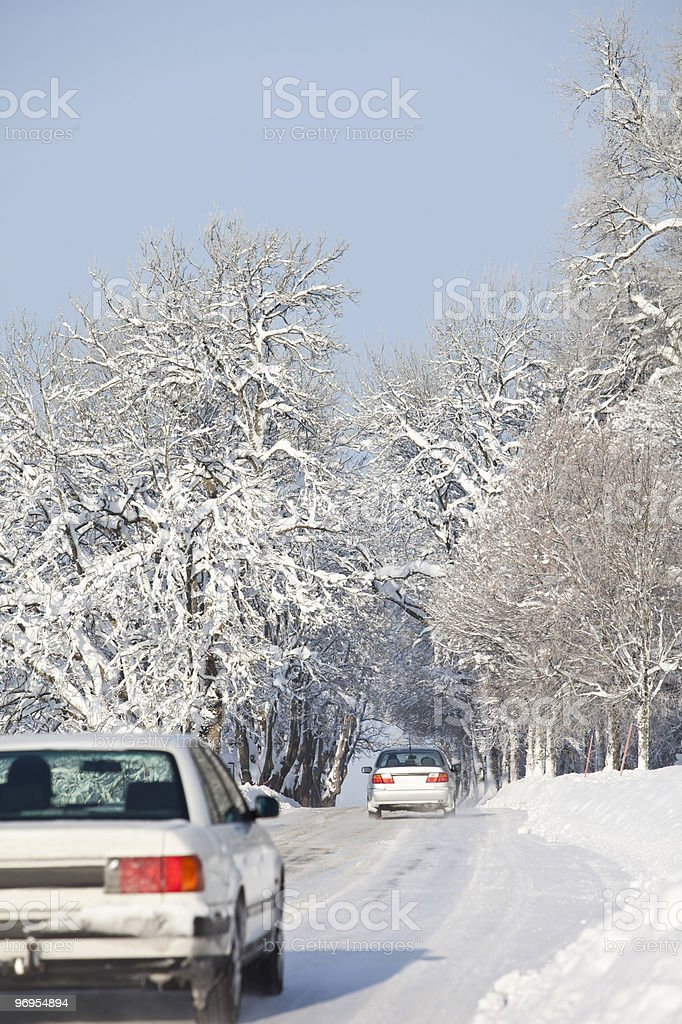 Cars on a winter Road royalty-free stock photo