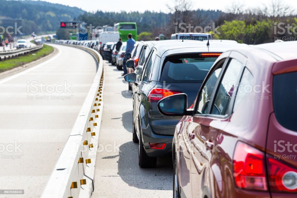 Cars on highway in traffic jam stock photo
