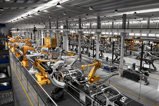 High angle view of cars on production line in factory. Many robottic arms doing welding on car metal body in manufacturing plant. Image in 3D render.