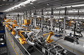istock Cars on production line in factory 1320950393