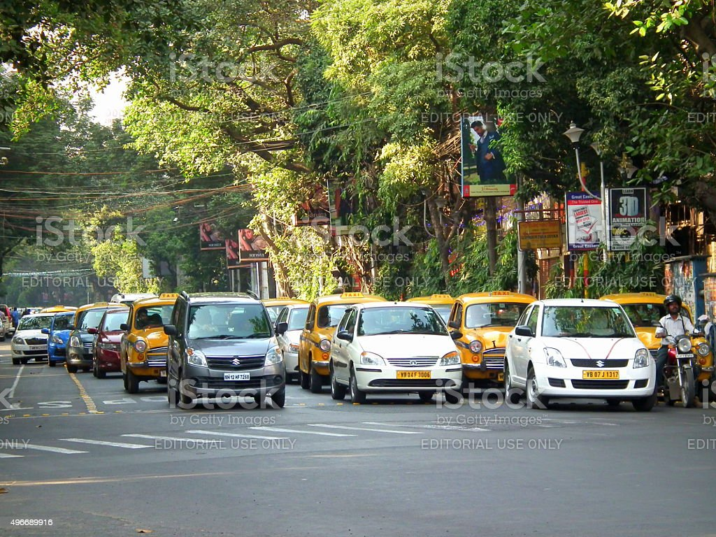 Cars on road waiting for traffic signal stock photo