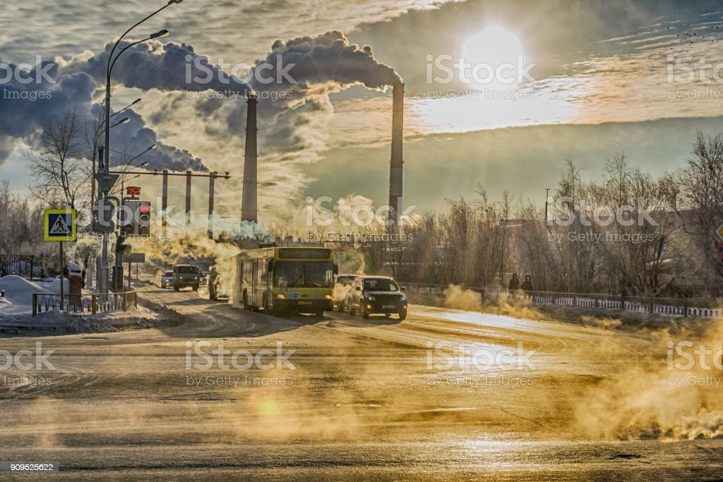 cars on the background of smoke from factories stock photo