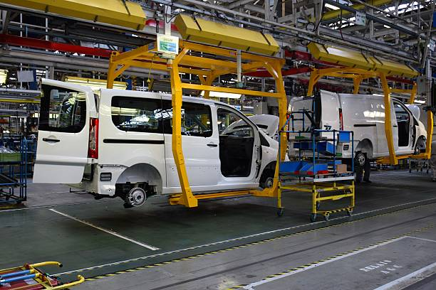 Cars on the production line Valenciennes, France - March 30th, 2016: Cars production line in Sevelnord factory in France. The Assembly Plant produces the following models: Citroen Jumpy/Spacetourer, Peugeot Expert/Traveller, Toyota Proace and Fiat Scudo (to the end 2016). The manufacturing line was adapted for an annual capacity of 180 000 cars. vehicle brand name stock pictures, royalty-free photos & images