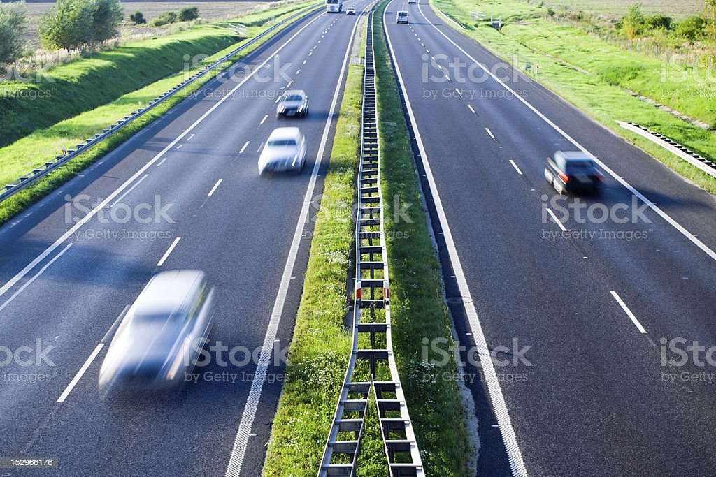 Cars on the road, highway motion blur royalty-free stock photo