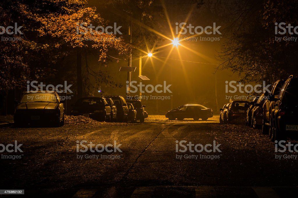 Cars parked at night stock photo