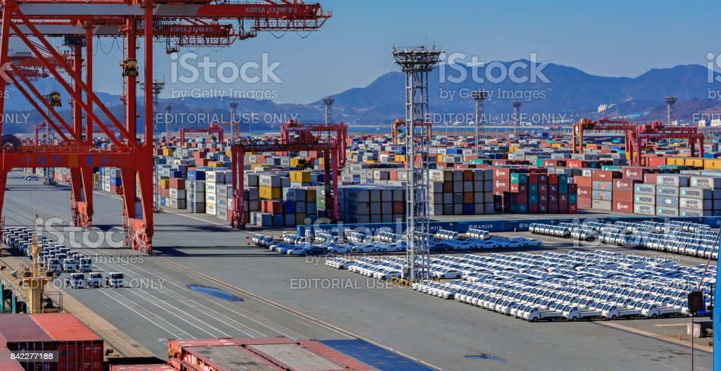 Cars parked at the Gwangyang port waiting to be loaded onto the vehicles carrier stock photo