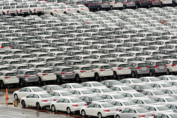 Cars Parked At The Singapore Port Waiting To Be Loaded Onto