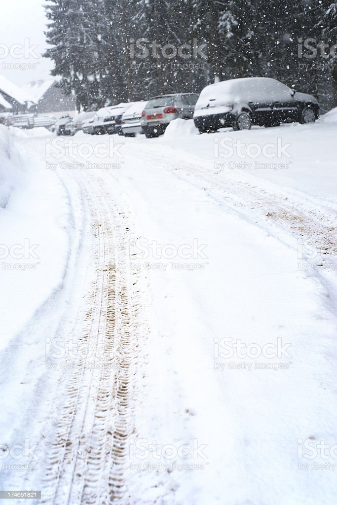 Cars parked by road covered with snow royalty-free stock photo