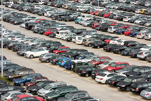 Cars parked in a large parking lot stock photo