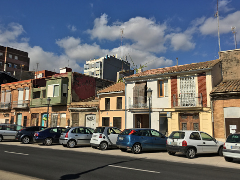Cars parked in front of houses in El Cabanyal district, Valencia, Spain