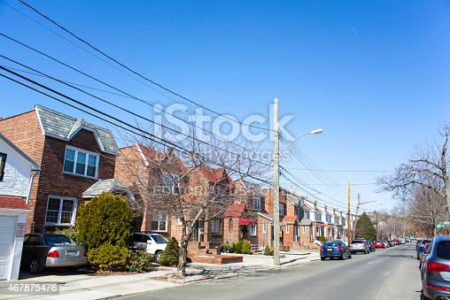 istock Cars Parked in Row Home Driveways 467875476