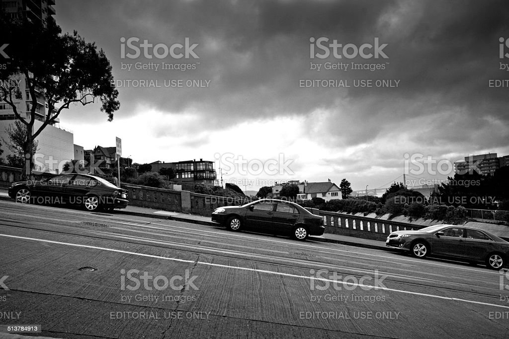Cars parked on steep street stock photo