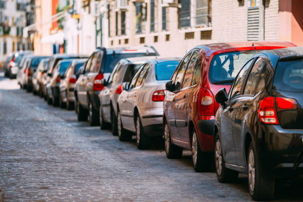 Cars Parked On Street In European City In Sunny Summer Day stock photo
