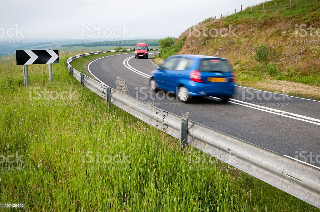 Cars Passing on a Corner stock photo