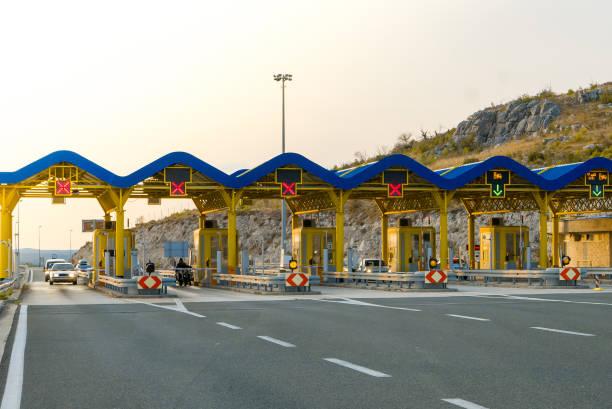 Cars passing through the toll gate on the motorway picture id854668552?b=1&k=6&m=854668552&s=612x612&w=0&h=jur70wvvtaeu4rbkovjmx7tjwi5kllevptzkjeli1 y=