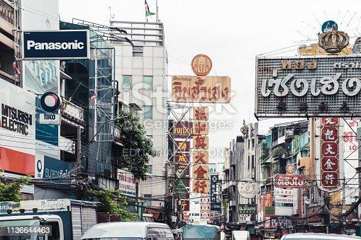 Bangkok, Thailand - January 3, 2019: Chinatown in Bangkok. Cars, people and tuk-tuk in the main street of Chinatown in Bangkok