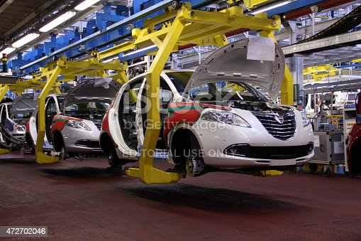 Tychy, Poland - June, 16th, 2011: Cars production line in Fiat factory in Poland. The Assembly Plant ensures both the production of the Fiat range models (Panda II, 500), Lancia/Chrysler Ypsilon and Ford Ka. The manufacturing line was adapted for an annual capacity of 600,000 cars