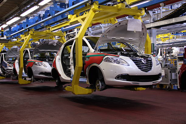 Cars production line Tychy, Poland - June, 16th, 2011: Cars production line in Fiat factory in Poland. The Assembly Plant ensures both the production of the Fiat range models (Panda II, 500), Lancia/Chrysler Ypsilon and Ford Ka. The manufacturing line was adapted for an annual capacity of 600,000 cars vehicle brand name stock pictures, royalty-free photos & images