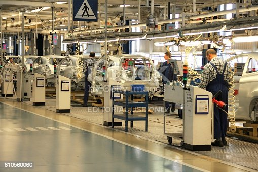 657996382 istock photo Cars production line 610560060
