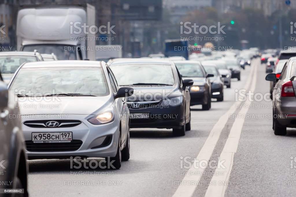 Cars standing in a traffic jam on one of the streets in Moscow. stock photo