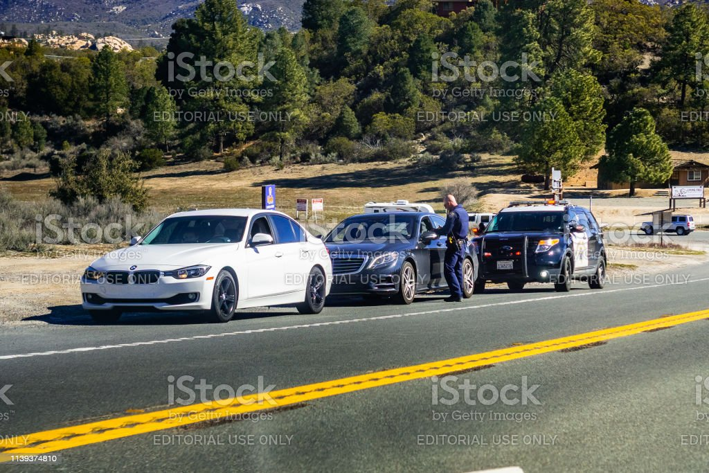 March 17, 2019 Idyllwild / CA / USA - Cars stopped on the right side...