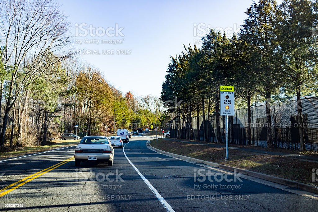 Cars waiting in traffic for school students to pass stock photo