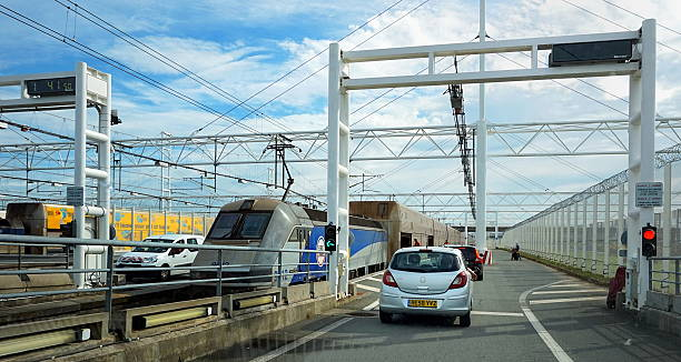 Cars waiting to board the EuroTunnel train to Folkestone  UK Coquelles, Pas-de-Calais, France - May 07 2016: Queue of cars waiting to board the Euro Tunnel train to Folkestone in the United Kingdom manche stock pictures, royalty-free photos & images