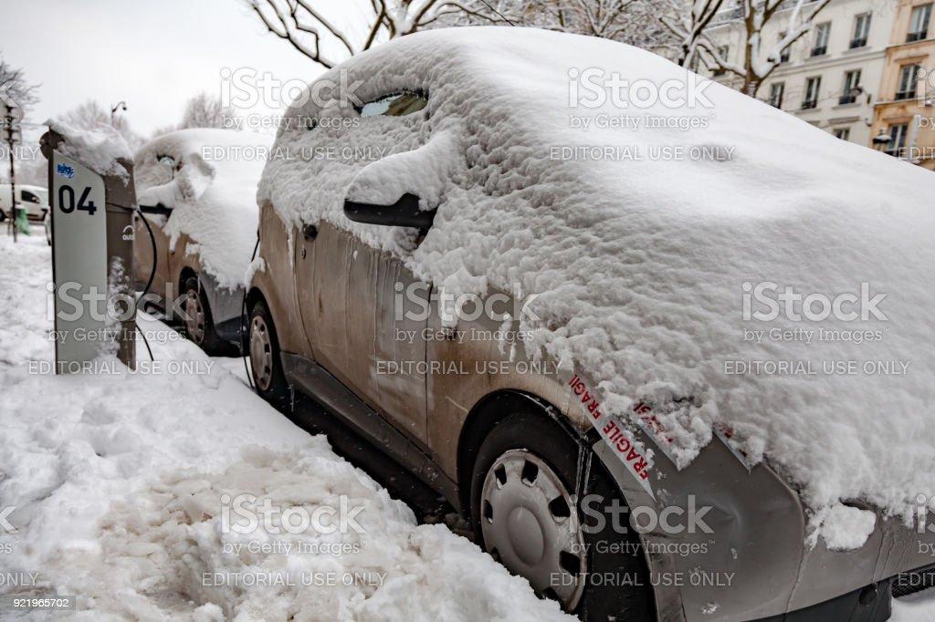 Carsharing Autolib under the snow stock photo