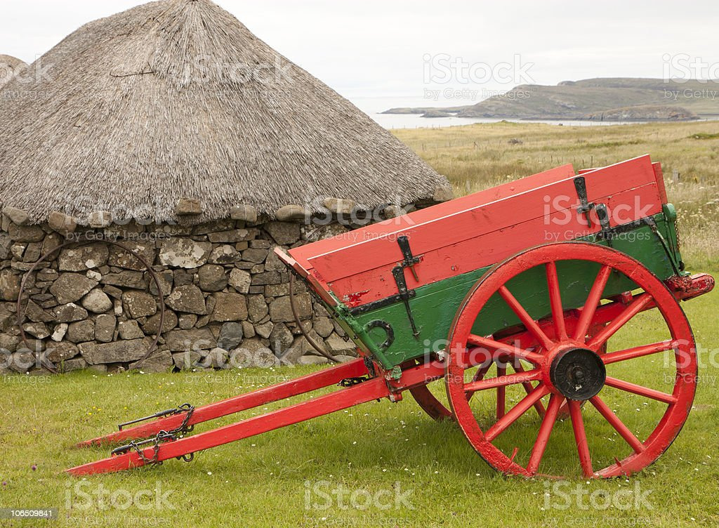 Cart and a hut stock photo