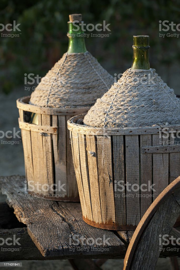 cart loaded with wine bottles stock photo