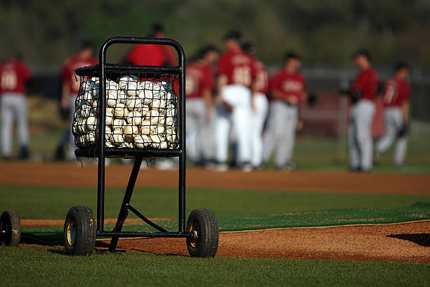 cart of baseballs - spring training stock photos and pictures