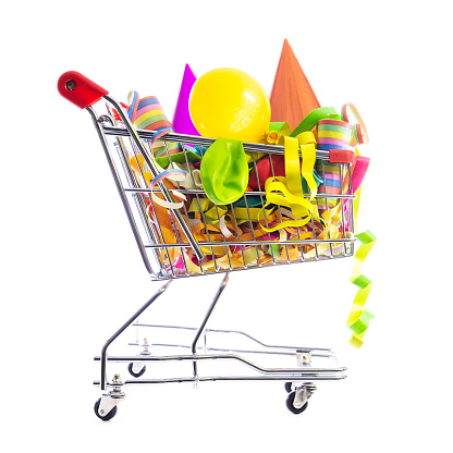 cart or shopping trolley full of carnival decoration, concept online shopping or mall, party or holidays