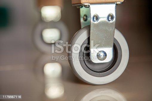 istock Cart wheels or trolley wheel metal transportation . 1179567116