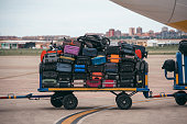 A cart full of luggage in an airport