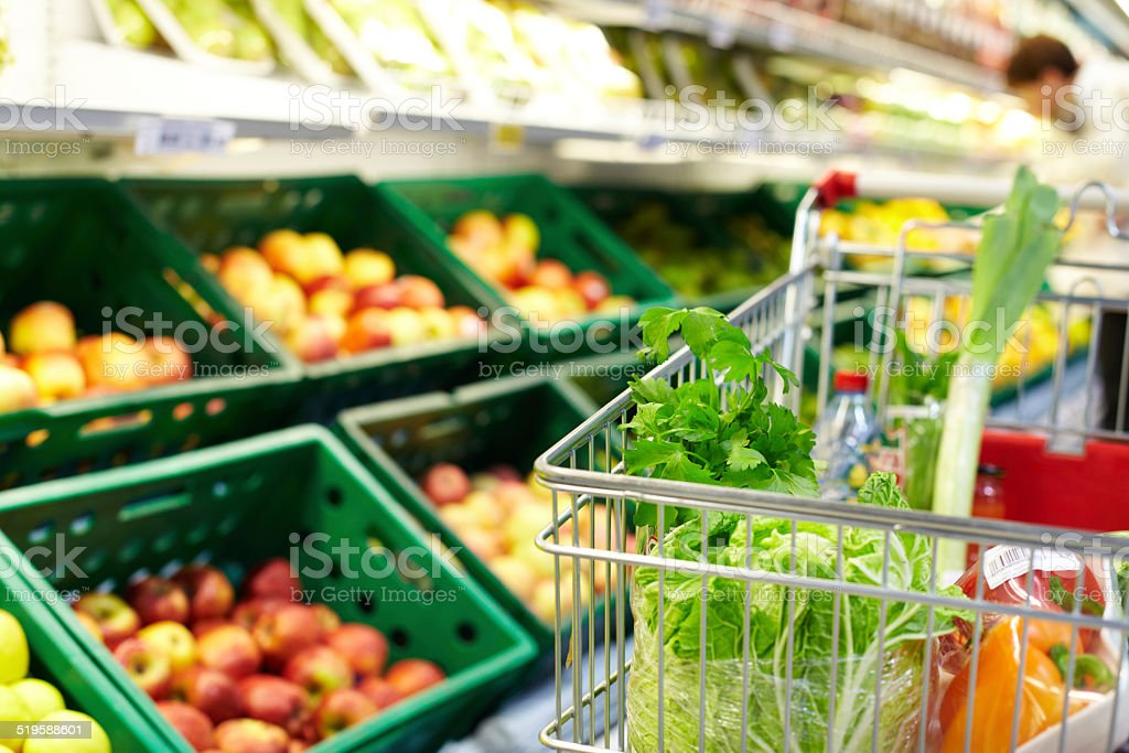 Cart with products Image of fresh vegetables in cart in supermarket Apple - Fruit Stock Photo