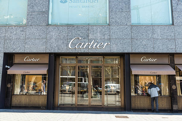 Cartier shop, Barcelona Barcelona, Spain - March 27, 2015: Cartier shop located on Passeig de Gracia, one of the most expensive streets in Europe. gracia baur stock pictures, royalty-free photos & images