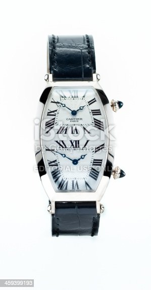 Leiden, The Netherlands - October 11, 2007: Product shot of a white gold Cartier Tonneau XL two time zones Collection Privee wristwatch for men on white background. This watch has a white gold case and a black alligator leather strap.