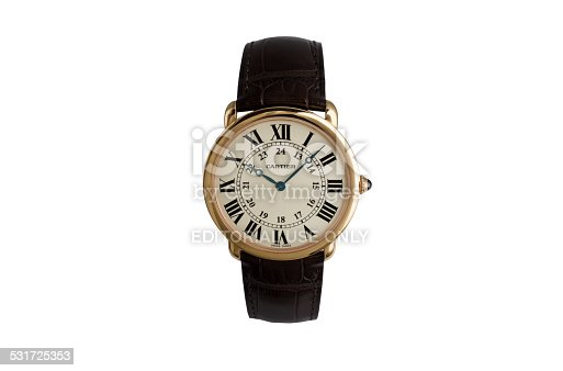 Berlin, Germany - January 10, 2015: Luxurious wrist watch from Cartier for men on white. Rosé golden wrist watch with blue hands and latin ciphers.