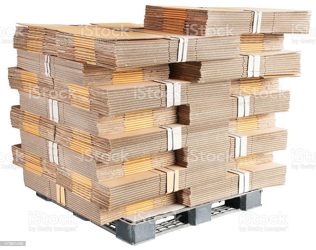 carton box parts on plastic pallet stock photo