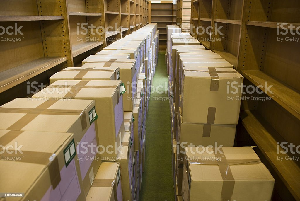 Carton boxes and empty bookshelves royalty-free stock photo
