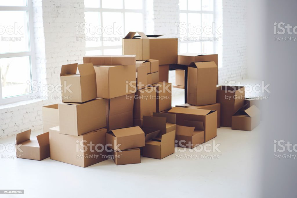 Carton boxes full of office goods stacked stock photo