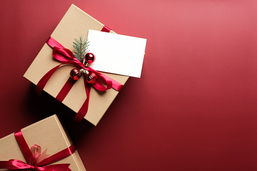 Christmas gift boxes on white and red background with copy space