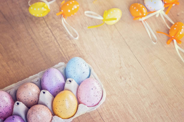 A carton of handmade Easter eggs decorations stock photo