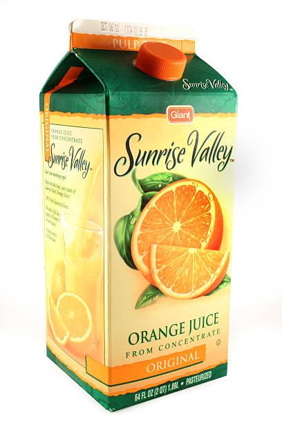 Carton de jus d'Orange de se concentrer et de Giant Sunrise Valley - Photo