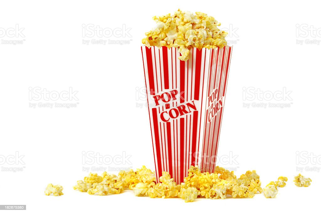 A carton of popcorn with some spilled royalty-free stock photo
