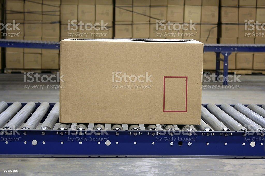 Carton on conveyor stock photo