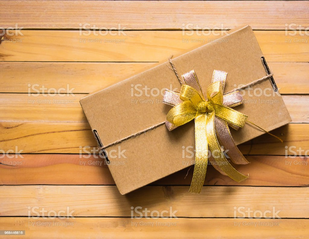Carton Ribbon binding on wood background for product packaging pack,...