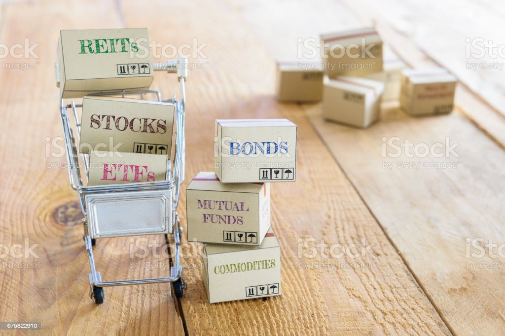 Cartons of financial investment products in a shopping cart. stock photo